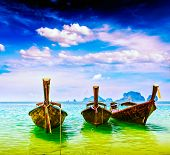 image of boat  - Vintage retro effect filtered hipster style travel image of long tail boats on tropical beach - JPG