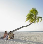 stock photo of palm-reading  - Couple reading at the beach - JPG