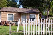 stock photo of neglect  - Small neglected house with a lawn - JPG