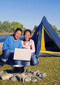 pic of mongolian  - Mongolian sisters using a laptop while camping - JPG