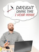 image of daylight-saving  - An image of a handsome business man thinking about the daylight saving time - JPG