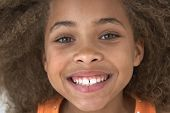 stock photo of tween  - Close up of young African American girl smiling - JPG