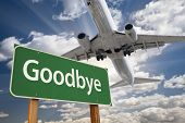 picture of bon voyage  - Goodbye Green Road Sign and Airplane Above with Dramatic Blue Sky and Clouds - JPG