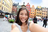 stock photo of selfie  - Asian woman taking self portrait selfie photo on Europe travel - JPG