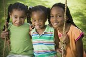 stock photo of pre-adolescent girl  - Portrait of African girls on swing - JPG