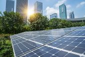 stock photo of thermal  - Solar Panels In The Park Of Modern City - JPG