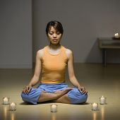 stock photo of pacific islander ethnicity  - Pacific Islander woman meditating - JPG