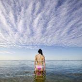 pic of pacific islander ethnicity  - Pacific Islander woman standing in ocean - JPG
