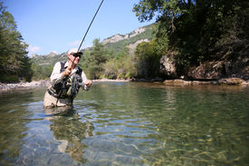 picture of fly rod  - Closeup of fisherman fly fishing in freshwater river - JPG