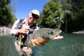 foto of fly rod  - Fly fisherman holding fario trout recently caught - JPG