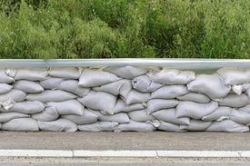 image of tarp  - Wall of sandbags and tarp for flood protection - JPG