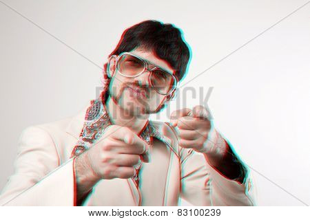 Instagram style portrait of a retro man in a 1970s leisure suit and sunglasses pointing to the camera with a 3D effect