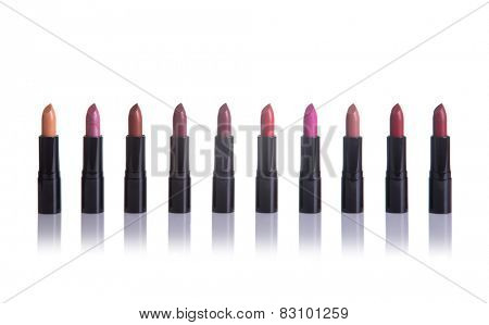 Set of lipsticks in fashionable colors, isolated on white background with natural reflection