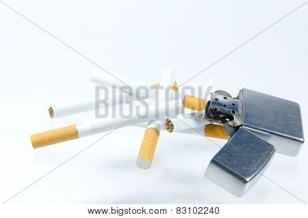 Cigarette And Lighter On White Background