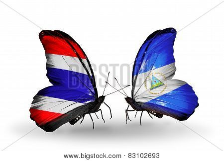 Two Butterflies With Flags On Wings As Symbol Of Relations Thailand And Nicaragua