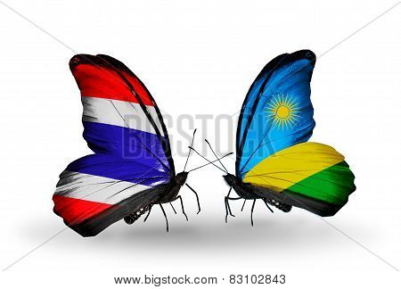 Two Butterflies With Flags On Wings As Symbol Of Relations Thailand And Rwanda