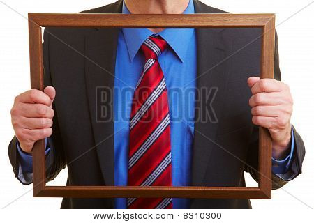 Tie And Suit In A Frame