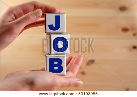 Job word spelled with wooden cubes