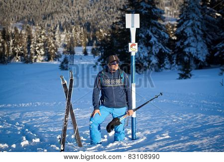 Cross-country skier taking a rest in beautiful nordic winter landscape