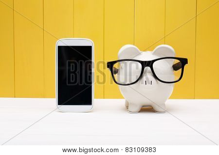 Piggy Bank Wearing Glasses With Cellphone