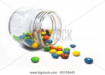 color candy in clear glass pot bottle