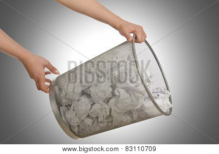 Hands with garbage bin with paper
