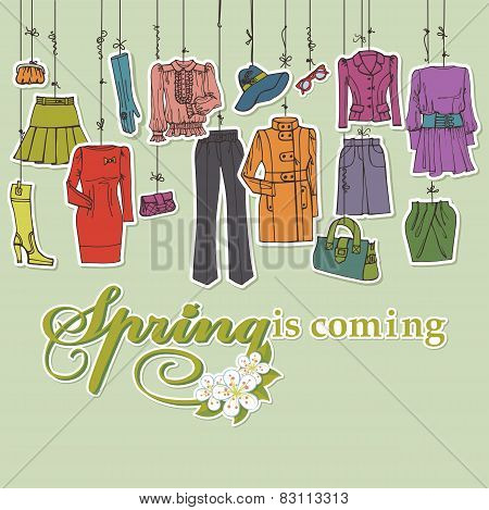 Womans clothing and accessories hanging on ropes.Spring