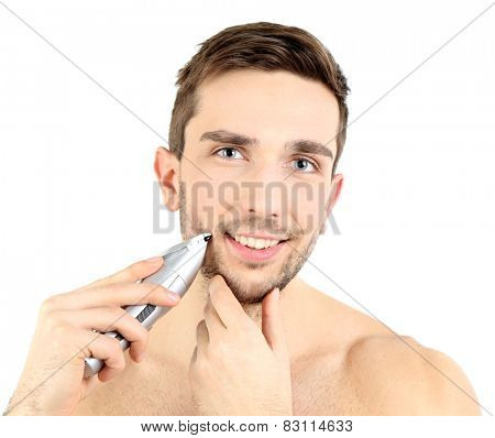 Handsome young man shaving his beard isolated on white