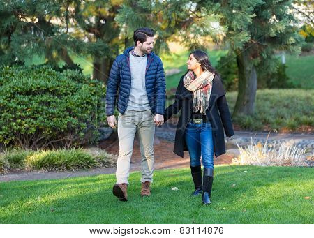 Couple In Love Running Outdoors Holding Hands