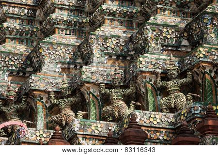 Demon Guardian Statues Decorating The Buddhist Temple Wat Arun In Bangkok, Thailand