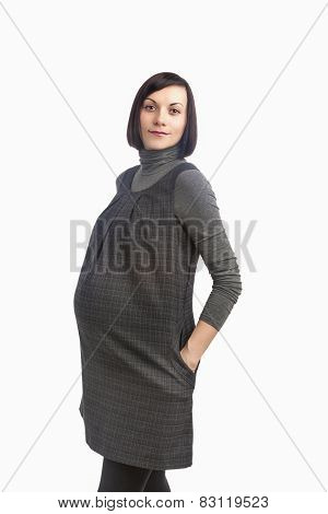 Portrait Of Beautiful Caucasian Pregnant Brunette Lady Expecting For A Baby. Isolated On White Backg