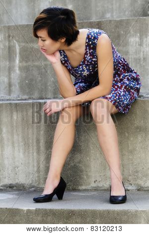 Young Attractive Asian American Woman Sitting Steps