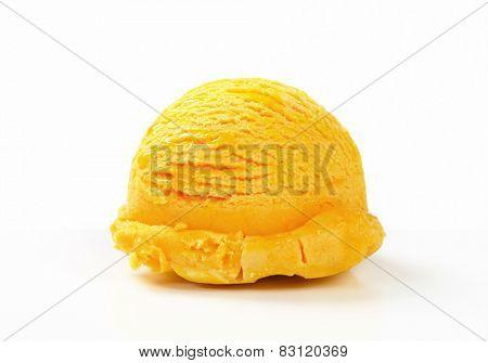Scoop of yellow ice cream on white background
