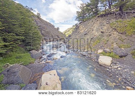 Fast Flowing Mountain Stream In A Narrow Canyon