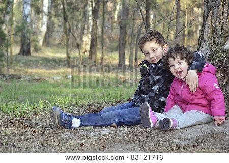 Spring In The Woods Sitting Curly Boy With The Little Girl They Laugh.