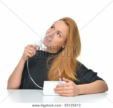 Woman Using Nebulizer For Respiratory Inhaler Asthma Treatment