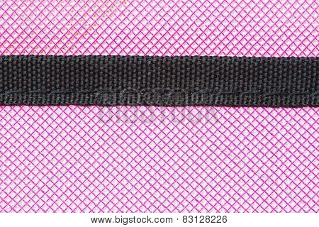 close-up pink soft case of tablet as background and texture with black stripe