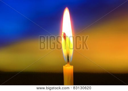 Flame of candle in darkness