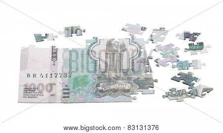 unfinished puzzle from one thousand Russian roubles isolated on white background