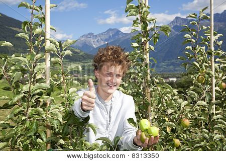 smiling teenager posing thumbs up