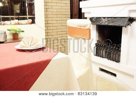 Restaurant table by the fireplace