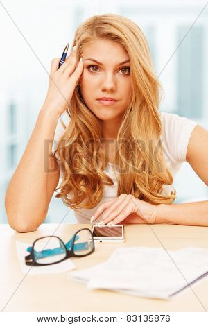 Young attractive woman doing her accounts