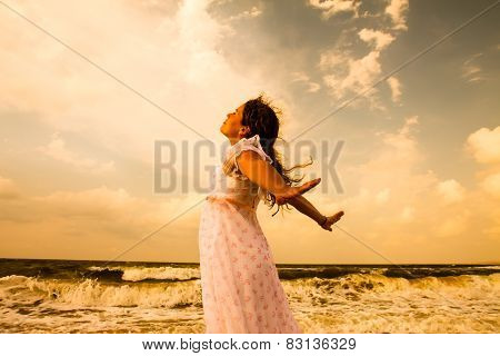 Beautiful Girl In White On Sunny Beach.  Freedom And Peace Concept