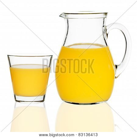 Orange Juice In A Glass And Carafe