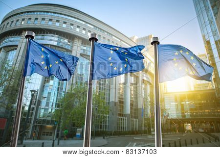 European union flag against parliament in Brussels, Belgium