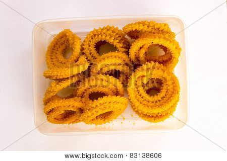 Spiral shaped, pretzel-like snack with a spiked surface Indian savoury called Chakri