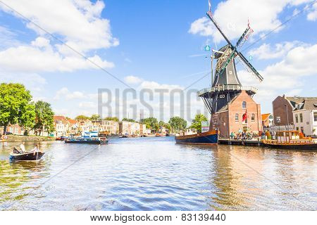 Typical windmill and medieval architecture in Haarlem