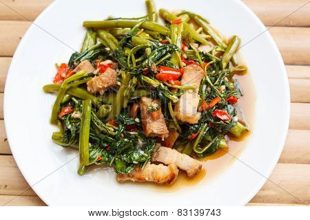 Fried Morning Glory With Crispy Pork.