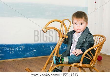 Little Boy On A Horse Rocking Chair