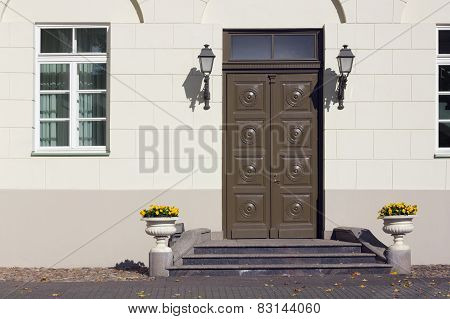 Yellow Wall And Old Brown  Wooden Door